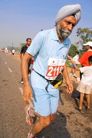 Delhi - October 28: Man Sikh man running on track at marathon on October 28th, 2007 in delhi, India.