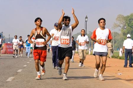 Delhi - October 28: Men running on track at marathon on October 28th, 2007 in Delhi, India. Stock Photo - 8945261