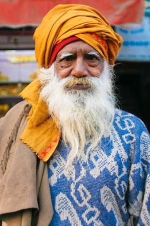 DELHI - JANUARY 19: Portrait of elderly bearded Brahman man with orange turban on January 19, 2008 in Delhi, India. Brahmans are considered the highest in the caste system.