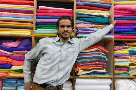 DELHI - JANUARY 19: Young indian promoting his textile fabrics on January 19, 2008 in Delhi, India. Textiles exports may touch $24 billion in 2010-11.