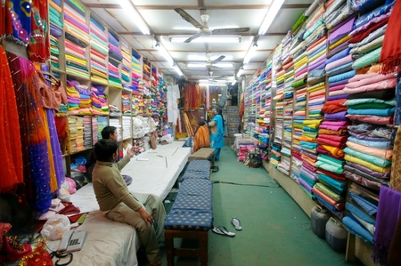 DELHI - JANUARY 19: Ladies choosing fabric for saris in textile shop on January 19, 2008 in Delhi, India. Saris can range from four to nine metres in length.