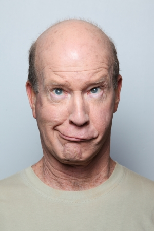 Man making funny face and grimacing photo