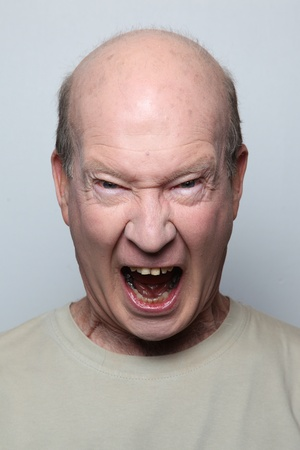 Angry man showing his teeth Stock Photo - 9658416