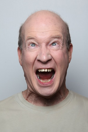 Angry man showing his teeth Stock Photo - 9658421