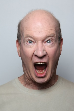 irritated: Angry man showing his teeth
