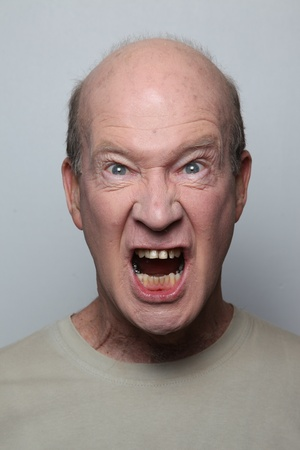 outrageous: Angry man showing his teeth