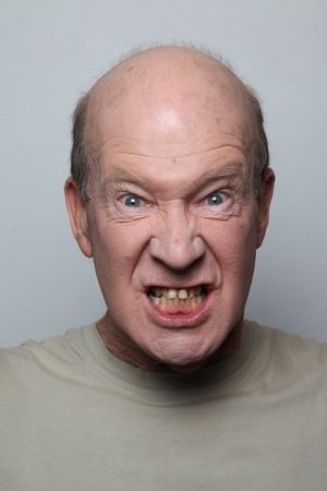 Angry man showing his teeth Stock Photo - 9658423