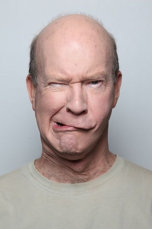 Man making funny face with mouth photo