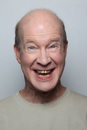 Man making funny face showing teeth photo