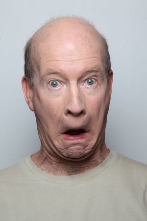 Man making surprised funny face photo