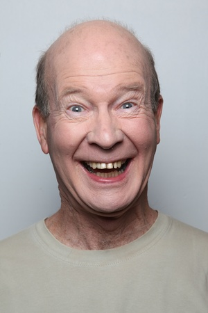 Man making funny face showing teeth