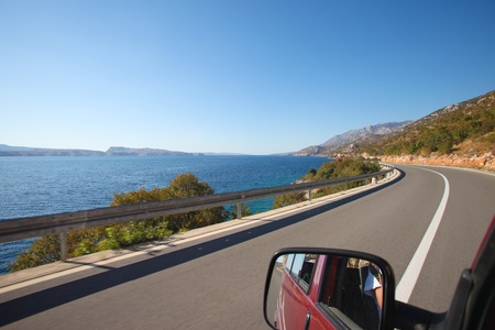 Drivers view of road and coast driving down the Croatian coast Stok Fotoğraf