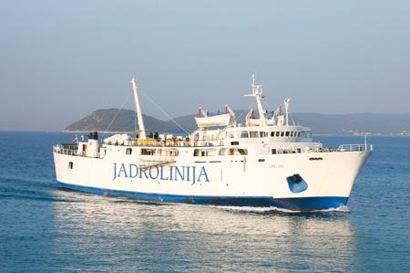 SPLIT - SEPTEMBER 24: Passenger ferry boat entering harbour on September 24, 2011 in Split, Croatia.