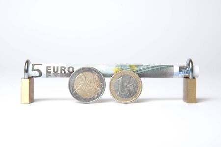 echange: Secured Euro bill rolled into padlock with coins in foreground, isolated on white background