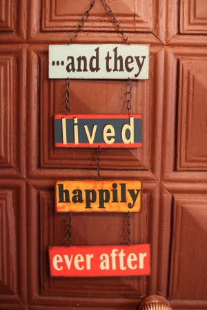ever:    and they lived happily ever after door sign on chain Stock Photo