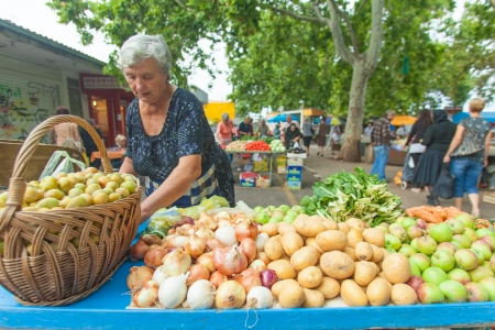 SPLIT - JULY 25  Old lady selling local produce on July 25, 2012 in Split, Croatia  Stari Pazar is Split