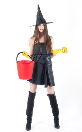 beautiful witch doing the cleaning with bucket photo