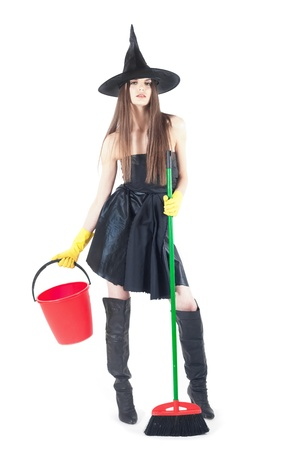 beautiful witch doing the cleaning with bucket