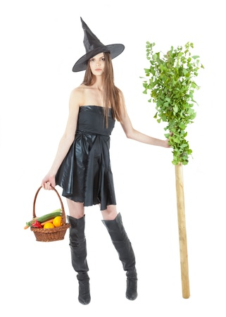 beautiful eco witch with a broomstick and vegetable basket Stock Photo - 15610004