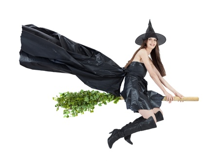beautiful witch flying on broomstick with cape Stock Photo - 15610003