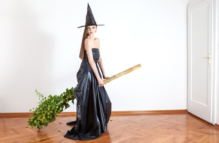 role models: beautiful witch tries out her new eco broom