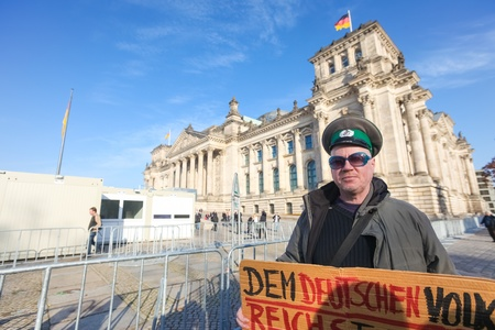 political system: BERLIN - NOVEMBER 3, 2011: Protester in front of the Bundestag on November 3, 2011 in Berlin, Germany. Citizens are becoming more disillusioned with the current political system.