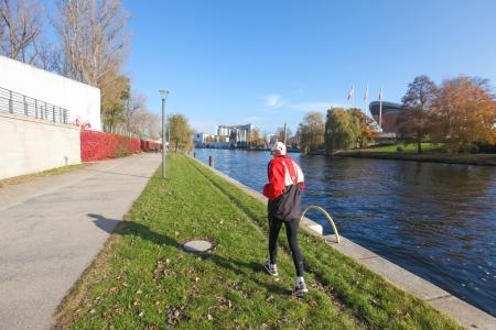 kilometres: BERLIN, GERMANY - NOVEMBER 3, 2011: Man runs along river Spree on November 3, 2011 in Berlin, Germany. River Spree is approximately 400 kilometres (250 mi) in length.
