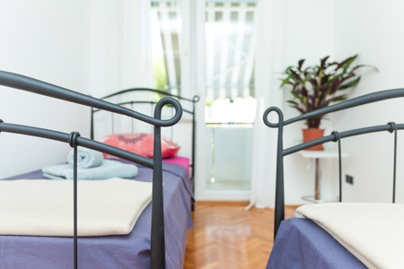 Clean and modern mediterannean bedroon in house Stock Photo - 16467331