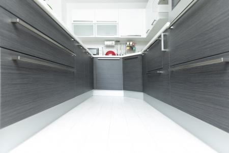 kitchen furniture: Open-plan kitchen interior perspective in modern home