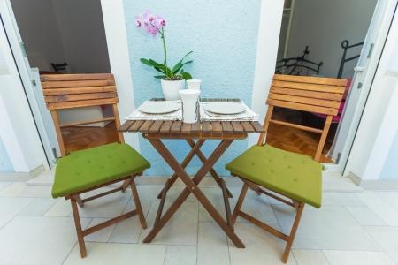 Table set on terrace for breakfast Stock Photo - 16467365