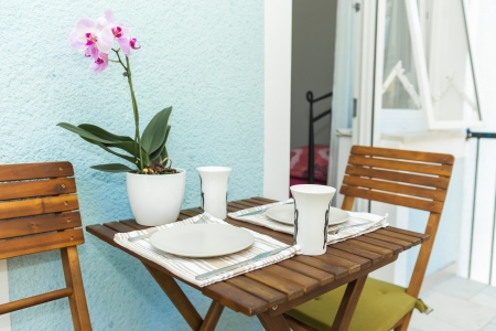 orchid house: Table set on terrace for breakfast Stock Photo