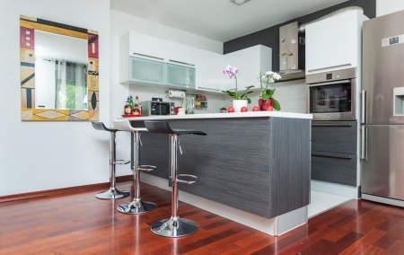 costly: Beautiful modern kitchen in designer house Stock Photo