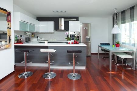 kitchen cabinets: Beautiful modern kitchen in designer house Stock Photo