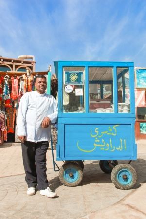 ambulant: DAHAB, EGYPT - JANUARY 29, 2011  Vendor on the street next to stand on January 28, 2011 in Dahab, Egypt  Street food is the cheapest way for tourists to get a meal