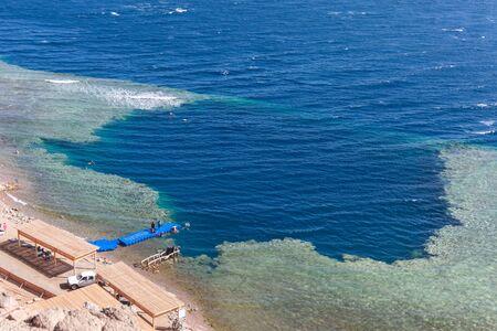 kilometres: Blue Hole is a popular diving location on east Sinai, a few kilometres north of Dahab, Egypt on the coast of the Red Sea.