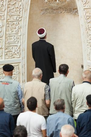 coran: Zagreb, Croatia - September 25, 2012  Zagreb Imam leading afternoon prayer in mosque on September 25, 2012 in Zagreb, Croatia  Zagreb Dzamija is one of Europe