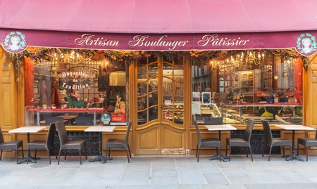 PARIS, FRANCE - JANUARY 6, 2012: Paris bakery with terrace in front on January 6, 2012 in Paris, France. Paris is well-known for its delicious breads and patisseries. Editöryel