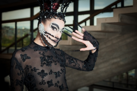 Woman in fashion clothes with mask ready for stage performance photo