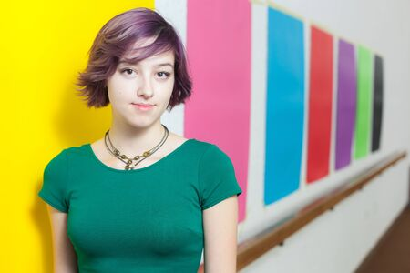 Cute modern and urban looking girl on multi-coloured background photo