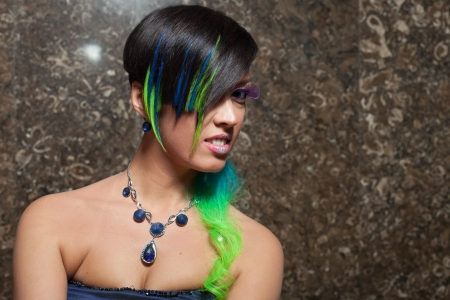 Portrait of funky bride with colourful hair and makeup