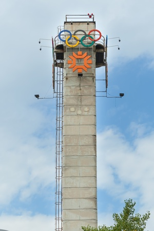 officially: SARAJEVO, BOSNIA - AUGUST 13, 2012  Tower with the logo of Olympic Games on August 13, 2012  The 1984 Winter Olympics, officially known as the XIV Olympic Winter Games took place in Sarajevo  Editorial