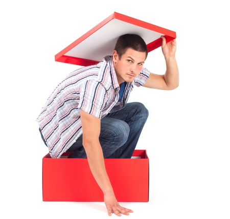 heaviness: Young man in a box with lid over his head, seems depressed