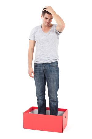stratching: Young man in a box, depressed and stuck in his thoughts.