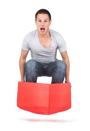 Man jumping with red box in excitement. Stock Photo - 16639918