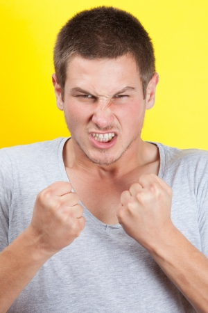 Young man clenching is fist in anger Stock Photo - 16630820
