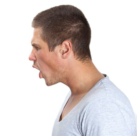 Young man shouting in profile on white isolated background photo