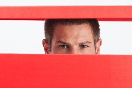 Concerned young man stuck in red box photo