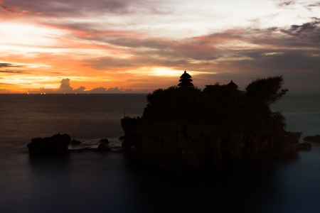 Tanah Lot temple at sunset in Bali, Indonesia photo
