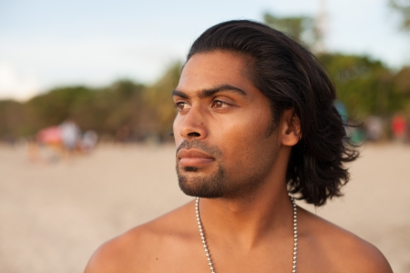 Portrait of handsome multi-ethnic man on beach at sunset Stock Photo - 17260037