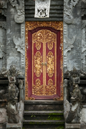 Entrance to indonesia hindu temple with carved wooden door. photo
